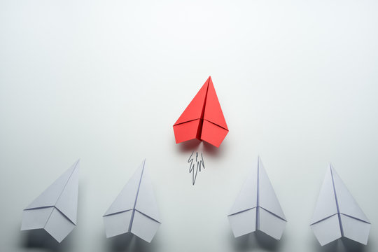 Red paper plane leader concept