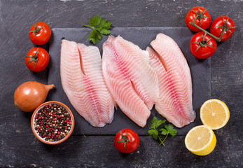 Foto op Canvas Vis fresh fish fillet with ingredients for cooking