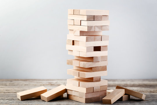 Wooden block tower game on grey table