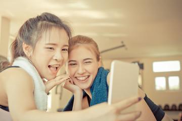 Friends in fitness is taking selfie photo on mobile