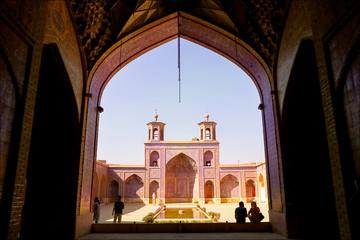 Iran, Shiraz, Mosque Nasir al-Mulk - September 17, 2016: Tourists and persian locals in a multi-colored mosque Nasir al Mulk.