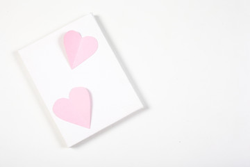 Origami paper heart pink color on white background.