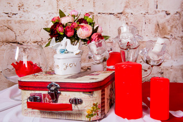 Table setting with lots of beautiful decoration. Interior for the celebration of St. Valentine's Day.