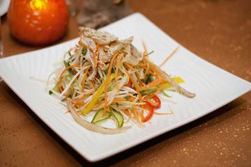 Salad on a plate.