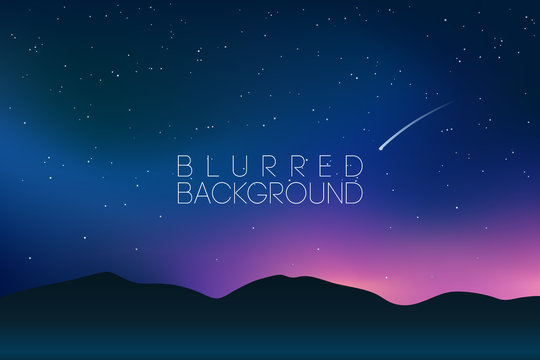 horizontal wide blurred mountain night sky background - night colors.