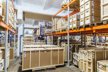 Logistic, industry, shipment, storage and manufacturing concept. Cargo boxes on shelves in warehouse. Industrial goods. Large long racks.