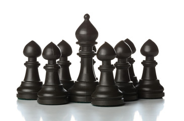 Runner chess figure standing in between pawn chess figures