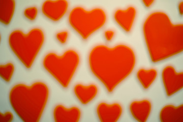 Blured erd hearts as background.
