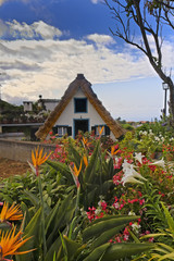 Traditional rustic cottage with thatched roof on Madeira island. Santana. Portugal.