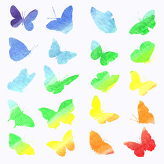 Watercolor collection of silhouettes of butterflies painted in rainbow colors.
