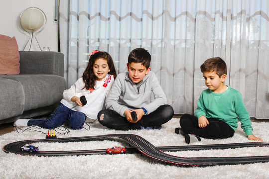 Three children playing car racing