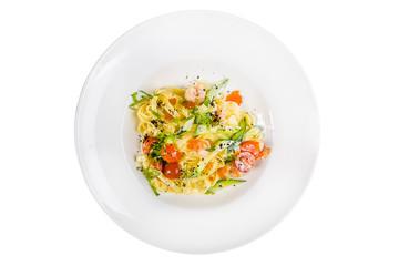 pasta, pasta, spaghetti, zucchini cut, cherry, tomato, shrimp, cheese sauce, red caviar, fresh herbs isolated on white background