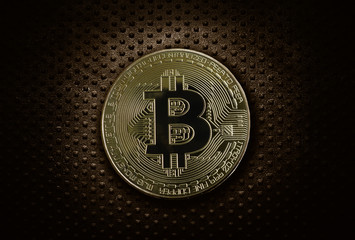Gold bitcoin on grunge metal