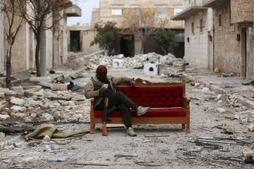A Turkey-backed Free Syrian Army fighter is seen in the eastern suburbs of al Bab