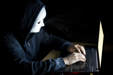 Young hacker  on a dark background