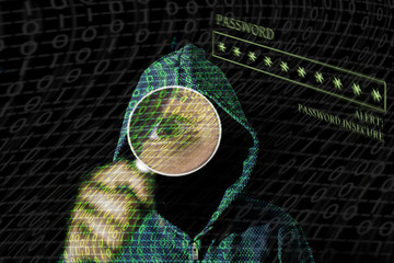 Young hacker in data security concept on a dark background  with magnifying glass in hand