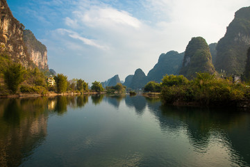 Aluminium Prints Reflection Amazing natural landscape. Beautiful karst mountains reflected in the water of Yulong river, in Yangshuo, Guangxi province, China.