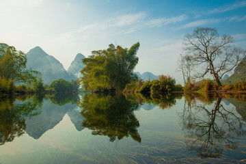 Printed roller blinds Reflection Amazing natural landscape. Beautiful karst mountains reflected in the water of Yulong river, in Yangshuo, Guangxi province, China.