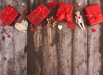 Valentines day background with hearts and gift box over wood board