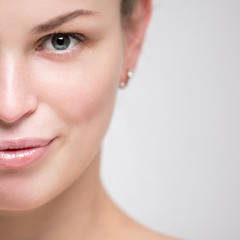 Portrait of a beautiful young woman. Female face closeup