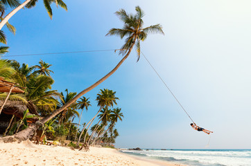 Teenage boy swinging