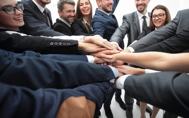 large business team standing with folded hands together
