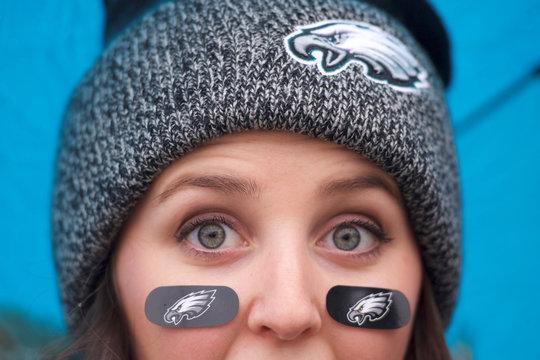 A fan wears Philadelphia Eagles logo themed bandages outside the Philadelphia Art Museum, before the Super Bowl LII game between the Philadelphia Eagles and New England Patriots, in Philadelphia