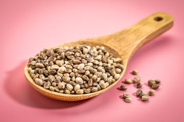 hemp seeds on wooden spoon