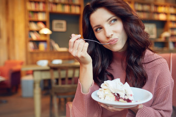 woman eat sweet dessert in a cafe