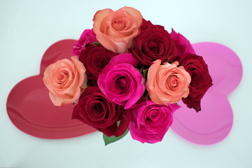 Bouquet of roses between two heart shaped plates
