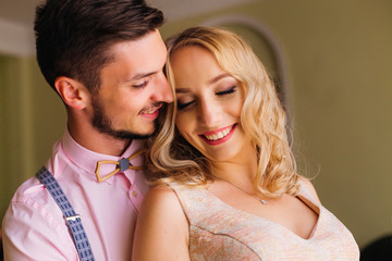 Close-up of a young couple who cute smile and embracing each other