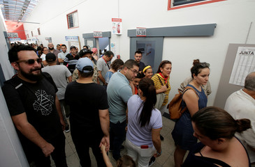 Voters wait in line to cast their vote at a polling station during Costa Rica's presidential election in San Jose
