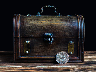 Open treasure chest with gold coins