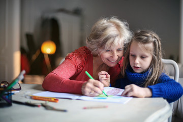 Grandmother and granddaughter drawing