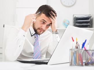 Man having problem in office