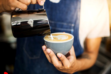 Barista hands to make art coffee