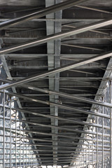 Architectural Detail of Mucem with metal pipe scaffolding and a metal walkway photographed from below.
