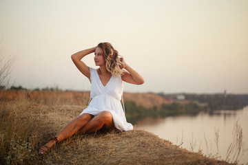 Lovely girl on the river bank
