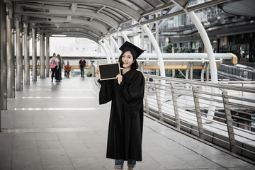 Graduate Woman Holding with blackboard.