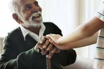 Senior man sitting talking with his relative