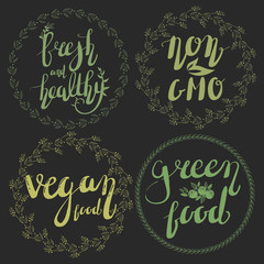 Fresh and healthy, non gmo, vegan food, green food. Hand-written lettering with cute nature wreaths