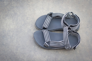 Sandals on concrete background