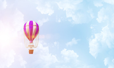 Flying hot air balloon in the air.