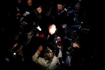 Belgian lawyer Mary, who is defending Salah Abdeslam, is surrounded by reporters as he arrives at Brussels Palace of Justice
