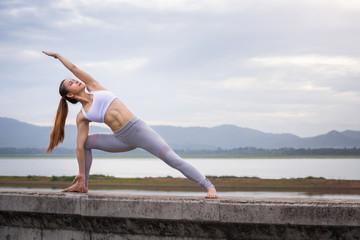 Asia woman doing yoga fitness exercise
