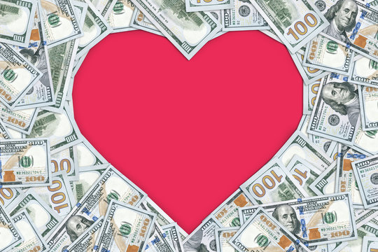 Heart shaped empty frame made with many 100 dollar banknotes
