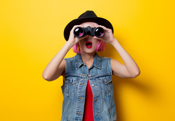 hipster girl with pink hair style with binoculars