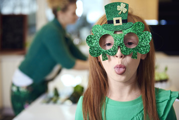 Portrait of playful girl celebrating Saint Patrick's Day