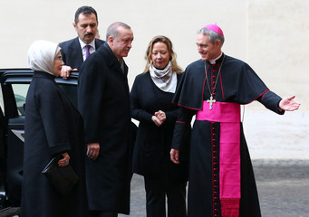 Turkish President Tayyip Erdogan is welcomed by archbishop Georg Ganswein as he arrives to attend a private audience with Pope Francis at the Vatican