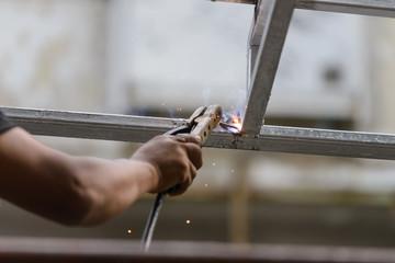 Industrial worker labourer welding steel structures